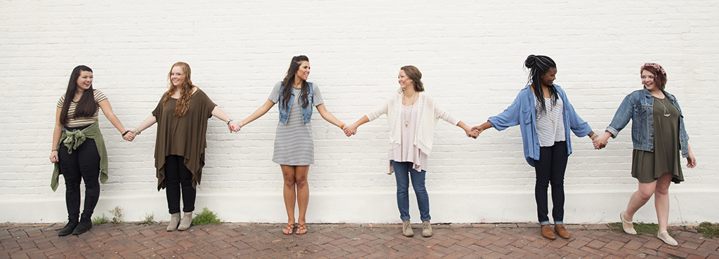 Image of Young Ladies Holding Hands in Friendship and Unity