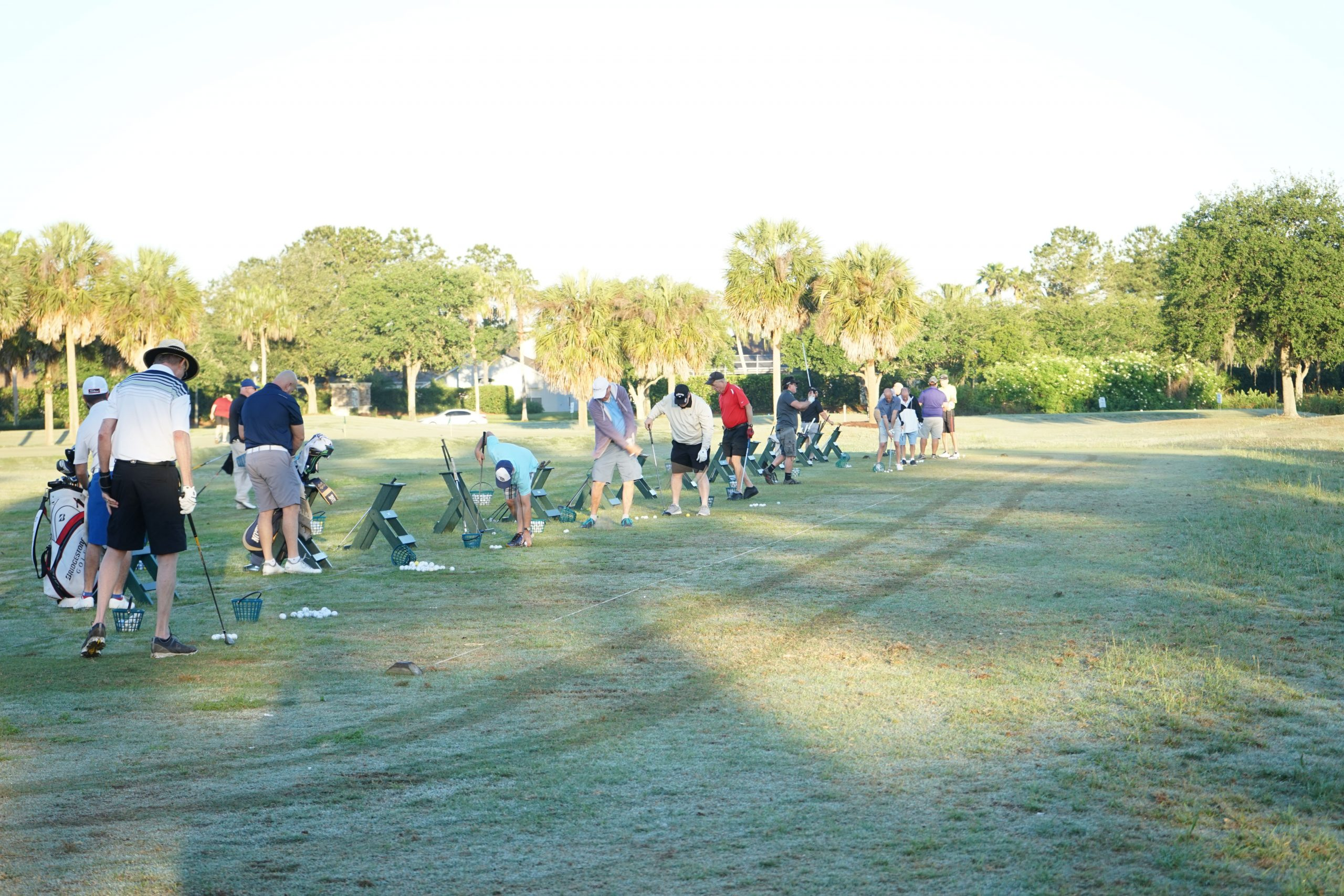 Picture of Golfers on Driving Range Prior to Oasis Golf Tournament