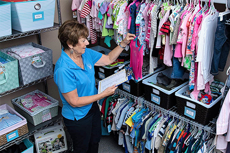 Picture of Volunteer Working in Baby Boutique